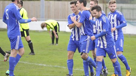 Godmanchester Rovers, with Jonny Hall, celebrate a goal against FC Clacton last season. Picture: Hel