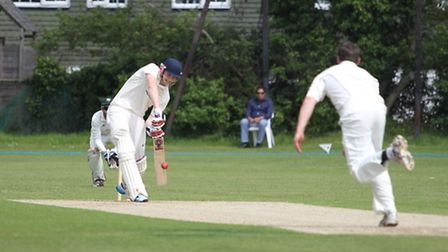 Joe Cooke hits one straight back down the wicket