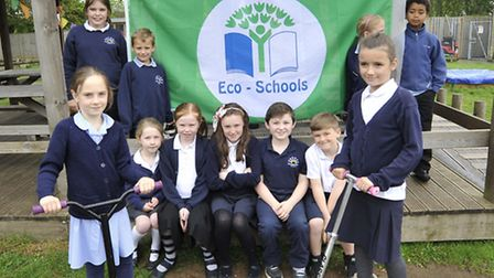 Hemingford Grey Primary School awarded Eco Flag, members of the Eco Committe and Bike Crew, hold it
