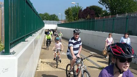 Cyclists on the awareness ride pass under the Royston rail underpass