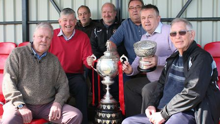 Huntingdon Town's directors with the Hinchingbrooke Cup at Jubilee Park. Picture: Richard Hughes