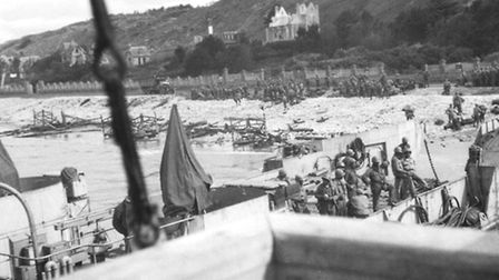 Troops assembling on the beach.