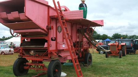 A Marshall threshing machine owned by Brian Spiers, of Wyboston. William Hickling is on top of the m