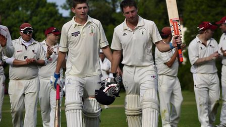 Reed's James Heslam is congratulated for his century in the VIllage Cup