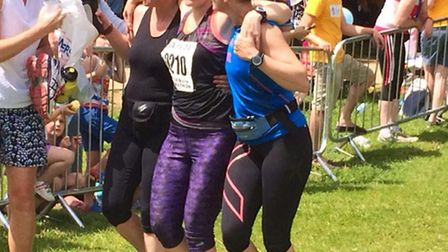 Abigail Giles is helped to complete the half marathon by Jo Gordon and her sister Vic Cowland