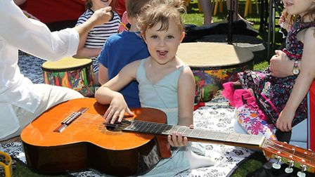 Ashleigh Burns, 4 plays the guitar at the family fun day