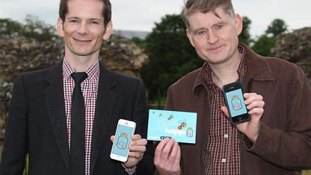 HappiJar founder Glen Cooper and graphic designer Richard with their iPhone app