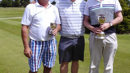 Nick Alderton presenting trophies to Vince Budd and Trevor Clifton .