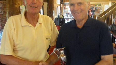 Captain Peter Hill presenting the trophy to Alan Flemming.