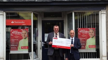 David Smyth and Tim Maris, UHY directors, with a £500 sponsorship cheque for Royston in Blue