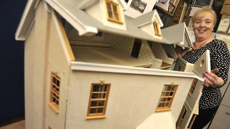 St Ives Councillor Deborah Reynolds, with her dolls house, being auctioned off, in aid of the Woodla