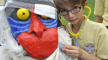 Godmanchester Scarecrows, St Annes Primary School pupil Matthew, with the patched up Lion King