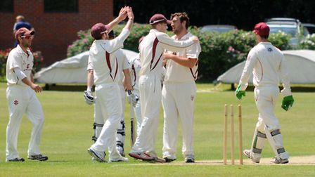 Will Jones bowls for Harpenden, celebrating bowling Louis Champion of WGC