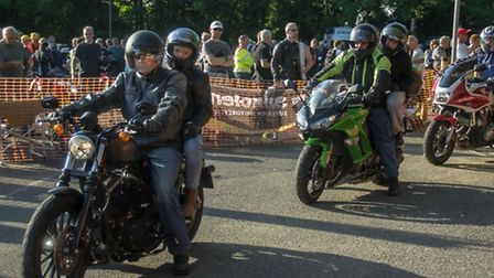 Motorcyclists arrive for the show