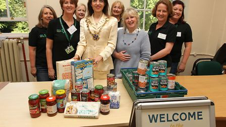 Food Bank manager Jane-Anne Wardley, Mayor of St Albans Cllr Annie Brewster and Food Bank Steering G