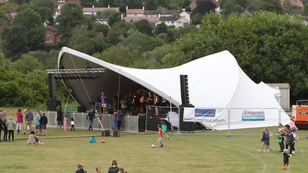The main stage of the 2014 Festival on the field at Sir John Lawes school
