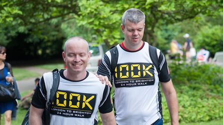 David Clarke, right, with guide and friend Steve Brady, walked 100km from London to Brighton in unde