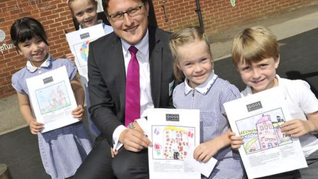 Giggs & Co drawing competition at Crosshall Infants School, Matthew Giggs with pupils (l-r) Mia Wilc