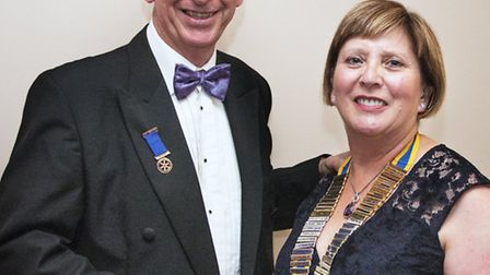 Ray Munden hands over the president's chain to Clarice Wahlich.