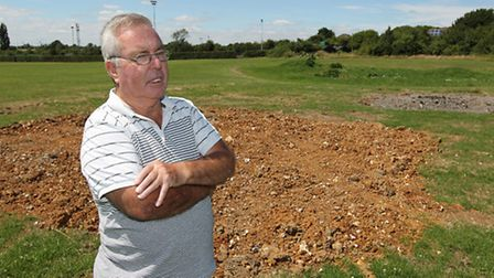 Keith Barrow stands on the field adjacent to Cotlandswick where there are plans to build a new sport
