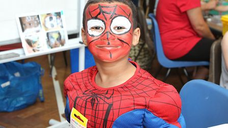 Leo Touray, 4 has his face painted as spiderman