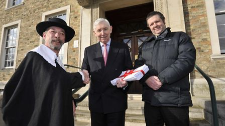 The Cromwell Museum petition is handed in at Shire Hall by (left) Bob Pugh.