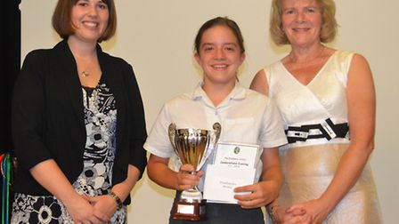 Laura Rawlings and Sue Kennedy present Alexa Thompson with the head teacher's award