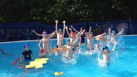 Meldreth Primary School pupils celebrate the reopening of their swimming pool