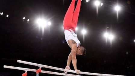 England's Louis Smith performs on the parallel bars in the Team Final and individual qualification a
