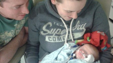 Left, dad Steven Frost and mum Cassie Davies during Finlay's hospital stay.