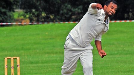 Riaz Anjum bowls against Peterborough Town III on his way to figures of 1-40.