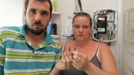 James Clarke and his partner Isabelle Dabare in the shower holding the damaged wires