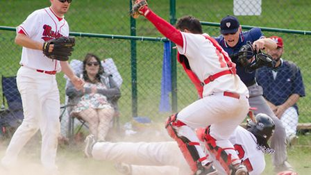 Jose Sosa slides in to home plate. Picture: Richard Lee Photography