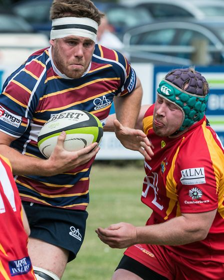 Billy Johnson about to be tackled by Cambridge hooker, Ean Griffiths. Picture: Chris Fell