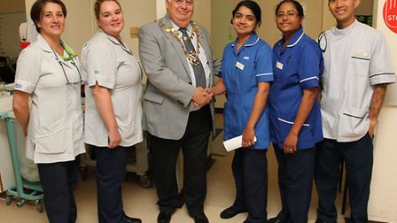 Staff from the Renal Dialysis unit at St Albans City Hospital are congratulated by the Mayor of St A