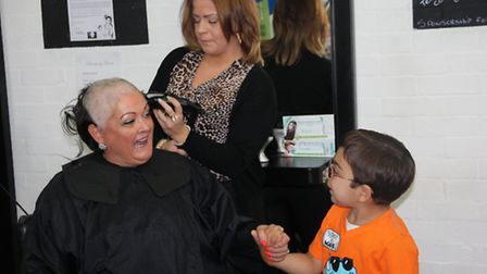 Allison Loveday's hair is shaved off by salon manager Laura Swales, watched by Emilio.