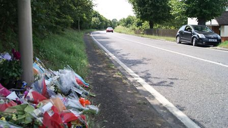 Flowers on the road where Jack Alexander, 20, died on July 17