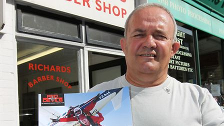 Vincenzo Picanza holds his certificate for the sky dive he completed to raise money for Keech Hospic