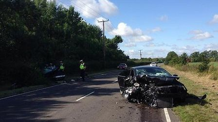 The two crashed cars following a head-on collision on the A141 at Warboys. Picture: BCH Road Policin