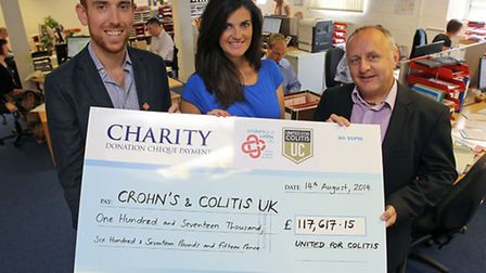 United for Colitis founders Jon & Diana McLeish present a cheque for £117617.15 to Crohn's and Colit