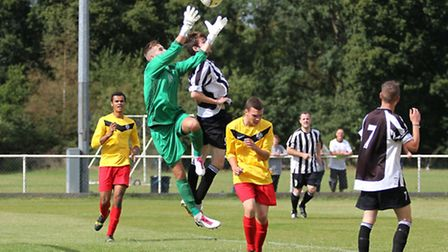 Aaron Clarke challenges the goalie for a high ball