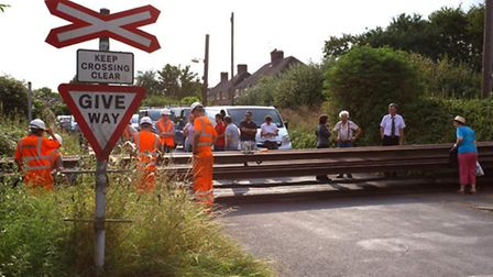 Residents take a look at the derailed wagon (Pic: Norman Cobley)