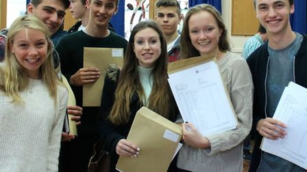 Students at Sir John Lawes celebrate recieving their GCSE results this morning