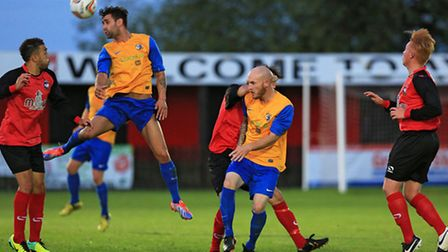 Kaan Fehmi wins wins a header for Royston at Aylesbury (Picture: KEVIN RICHARDS)