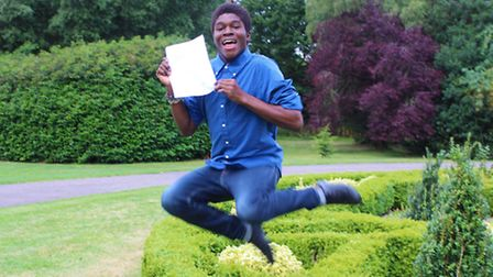 Aaron Gomez jumping for joy after receiving his A-Level results