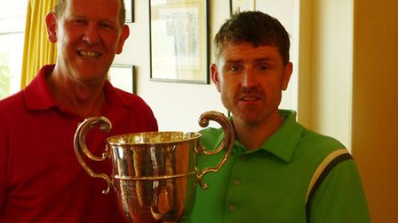 Darren Dawson (right) receiving the President's Cup from Royston Golf Club Vice Captain Nigel Thomas