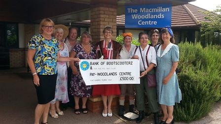 Members of Bootscooterz present a cheque for £500 to the Woodlands Cancer Centre.