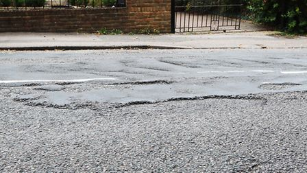 The potholed surface of Waverley Road
