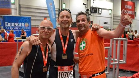 (from l-r) Gadget Show presenter Jason Bradbury with brothers Richard and Simon at the finish line