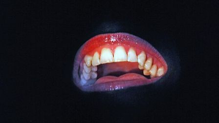 And all the audience sees is a big, red glowing mouth...